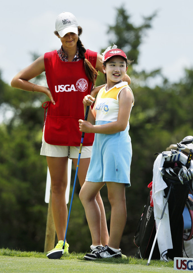 Lucy Li, 10, prepares to tee off on hole 10 as caddy Chelsey Franklin waits with her during the USGA Women's Public Links championship at Jimmie Austin OU Golf Course on Tuesday, June 18, 2013, in Norman, Okla.  Li set a national record for the youngest person to make it to match play for the tournament. Photo by Steve Sisney, The Oklahoman