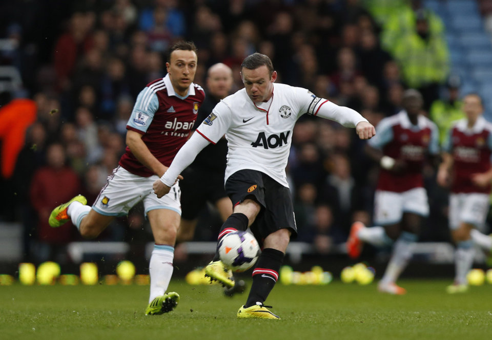 Photo - Manchester United's Wayne Rooney, right, scores from 45 yards out against West Ham United during their English Premier League soccer match at Upton Park, London, Saturday, March 22, 2014. (AP Photo/Sang Tan)