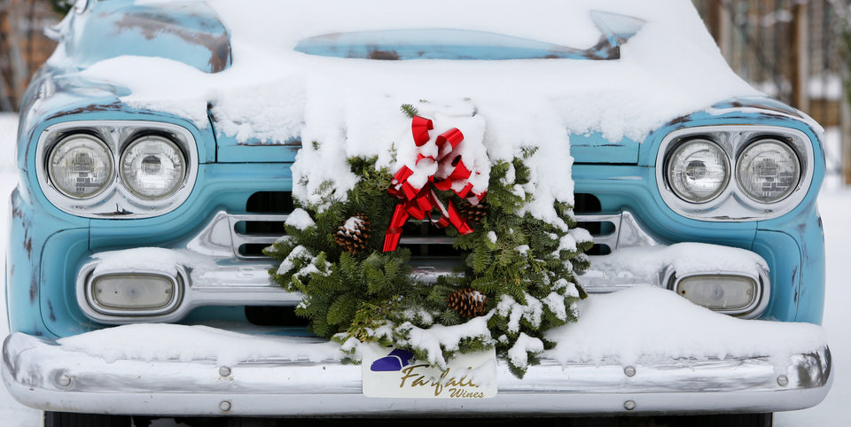 An old Chevrolet truck is covered in snow on Poplar Avenue in Yukon, Thursday December 6, 2013. Photo By Steve Gooch, The Oklahoman