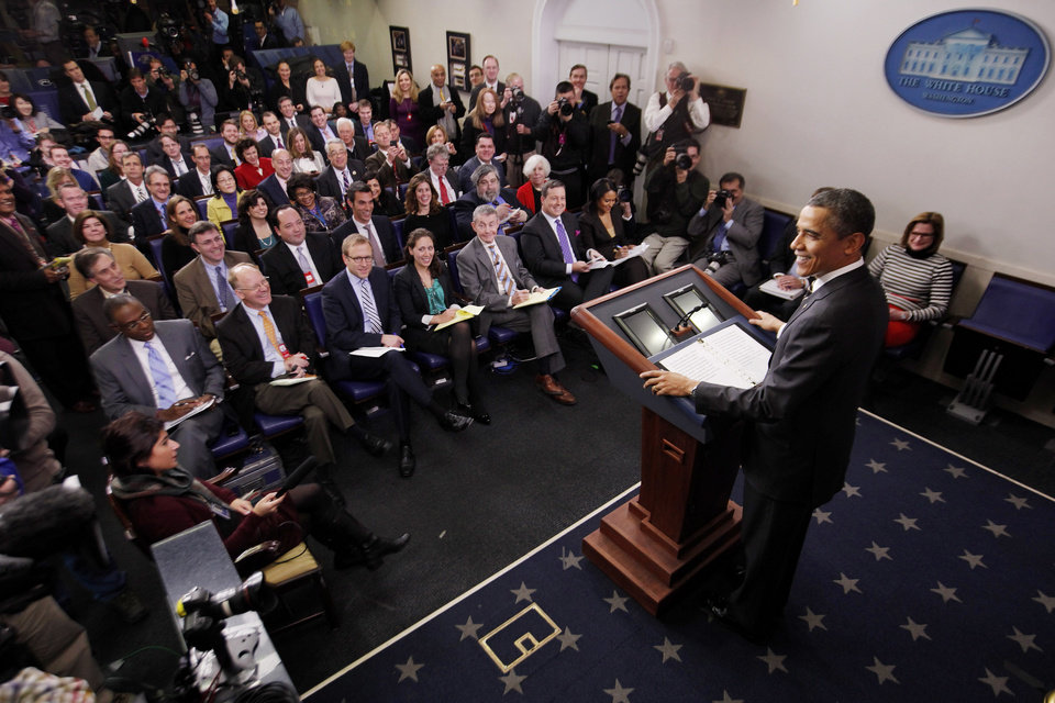 President Barack Obama and members of the press smile as he reacts to a noise coming from a camera as he speaks in the James Brady Press Briefing Room at the White House in Washington, Tuesday, Feb. 5, 2013. The president asked Congress to come up with tens of billions of dollars in short-term spending cuts and tax revenue to put off the automatic across the board cuts that are scheduled to kick in March 1. (AP Photo/Charles Dharapak)