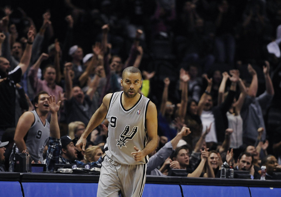 Photo - San Antonio Spurs guard Tony Parker, of France, reacts after scoring in the final seconds of an NBA basketball game against the Sacramento Kings on Saturday, Feb. 1, 2014, in San Antonio. San Antonio won 95-93. (AP Photo/Darren Abate)