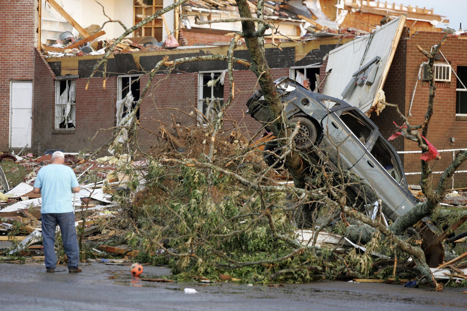 Photo - A car was thrown across a parking lot and up into a tree following a tornado Wednesday afternoon, April 27, 2011 in Smithville Miss. A wave of severe storms laced with tornadoes strafed the South on Wednesday.(AP Photo/Northeast Mississippi Daily Journal, Thomas Wells)