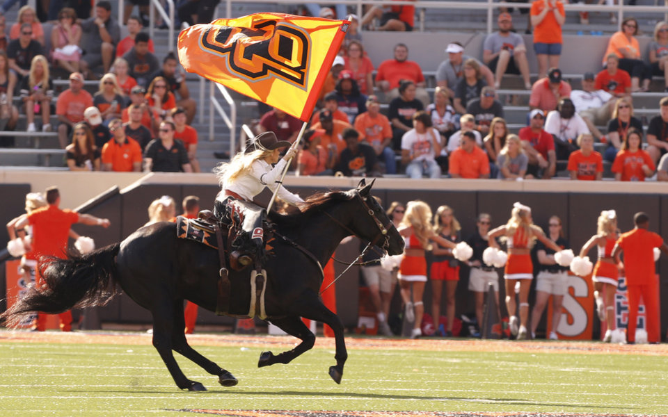 Photo - Bullet celebrates a score during the second half of a college football game between the Oklahoma State Cowboys (OSU) and the Southeastern Louisiana Lions at Boone Pickens Stadium in Stillwater, Okla., Saturday, Sept. 12, 2015. Photo by Steve Sisney, The Oklahoman