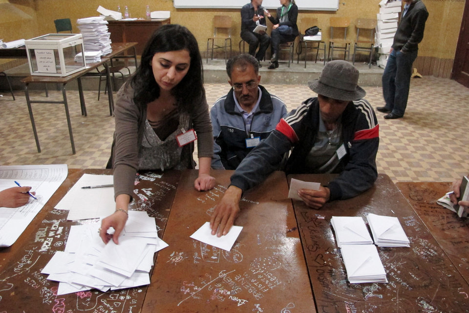 Photo -   Workers at a polling station count ballots at a polling station in the Bab el-Oued neighborhood, Algiers, Thursday, May 10, 2012. As parliamentary elections unfolded across Algeria on Thursday, voting was light for much of day in the capital, despite these contests being billed the freest in 20 years. (AP Photo/Paul Schemm).