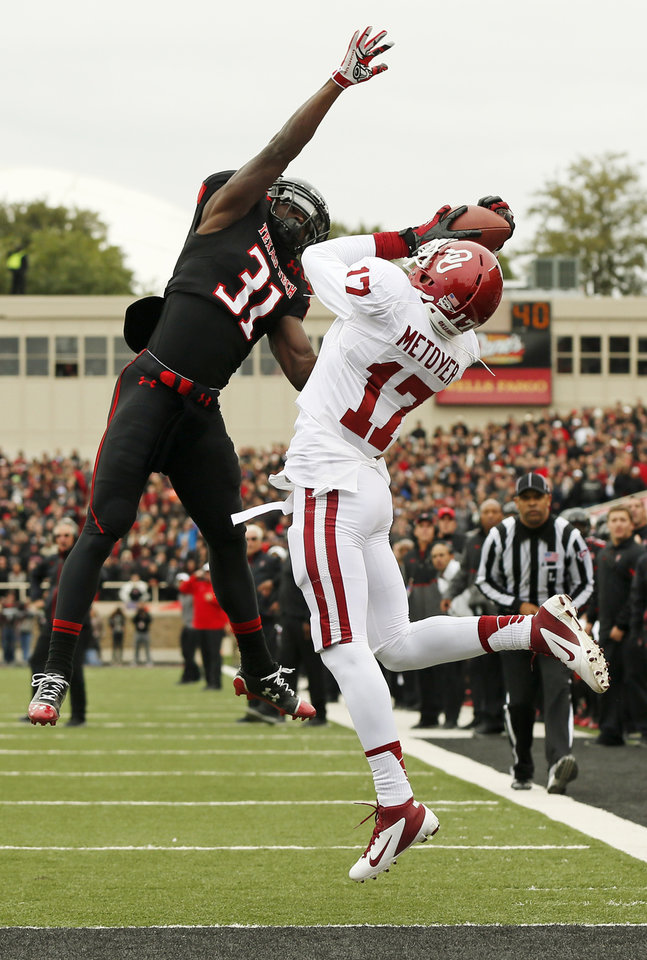 Photo - OU's Trey Metoyer (17) grabs the ball in the end zone before having it knocked out of his hands by Texas Tech's Eugene Neboh (31) during a college football game between the University of Oklahoma (OU) and Texas Tech University at Jones AT&T Stadium in Lubbock, Texas, Saturday, Oct. 6, 2012. Photo by Nate Billings, The Oklahoman
