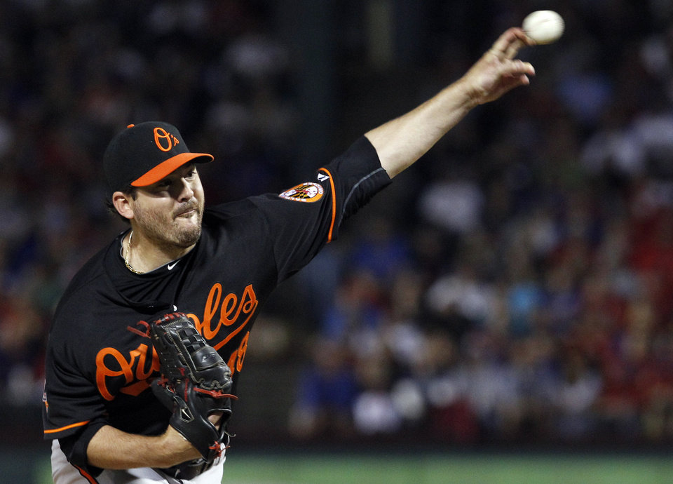 Photo -   Baltimore Orioles starting pitcher Joe Saunders throws to a Texas Rangers batter during the third inning of an American League wild-card playoff baseball game Friday, Oct. 5, 2012, in Arlington, Texas. (AP Photo/LM Otero)