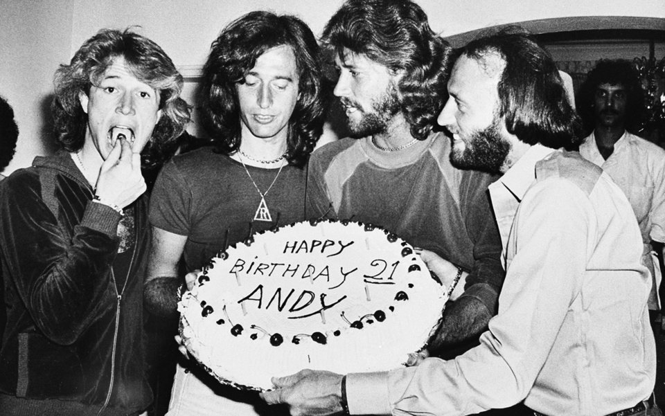 Photo -   In this March 6, 1979, file photo, Andy Gibb eats a cherry from his birthday cake at a party given by his family in his home in Miami Beach, Fla. A representative said on Sunday, May 20, 2012, that Gibb has died. He was 62. (AP Photo/File)