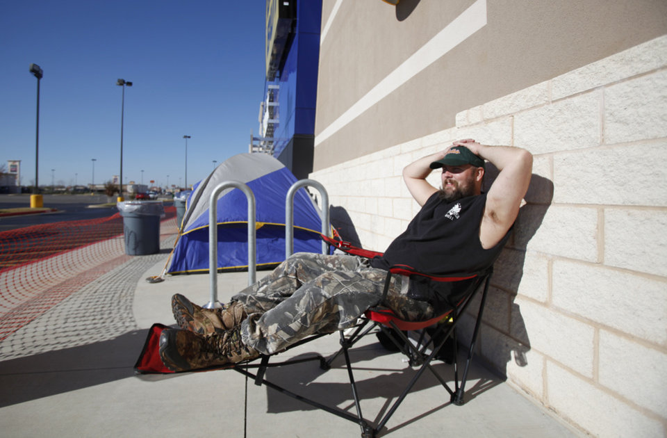Mike Anderson waits for Black Friday shopping bargains at Best Buy on South Pennsylvania in Oklahoma City, Thursday November, 24,  2011. Oklahoman Photo by Steve Gooch