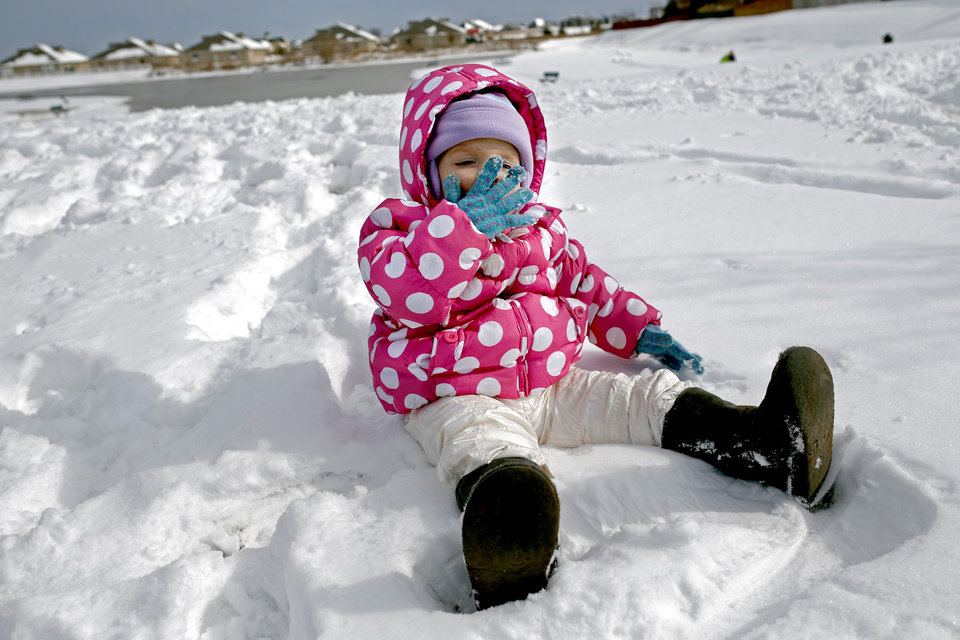 Ivy Campbell, 18 months, tries eating snow for the first time in a neighborhood near 164th and Penn in northwest Oklahoma City, Okla.,  Friday, Dec. 6, 2013. Photo by Sarah Phipps, The Oklahoman