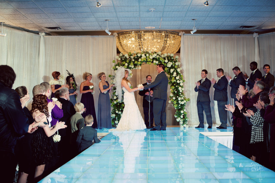 Photo - Michael and Malorie Gulikers exchange vows at their wedding. Photo by Traina Photography.