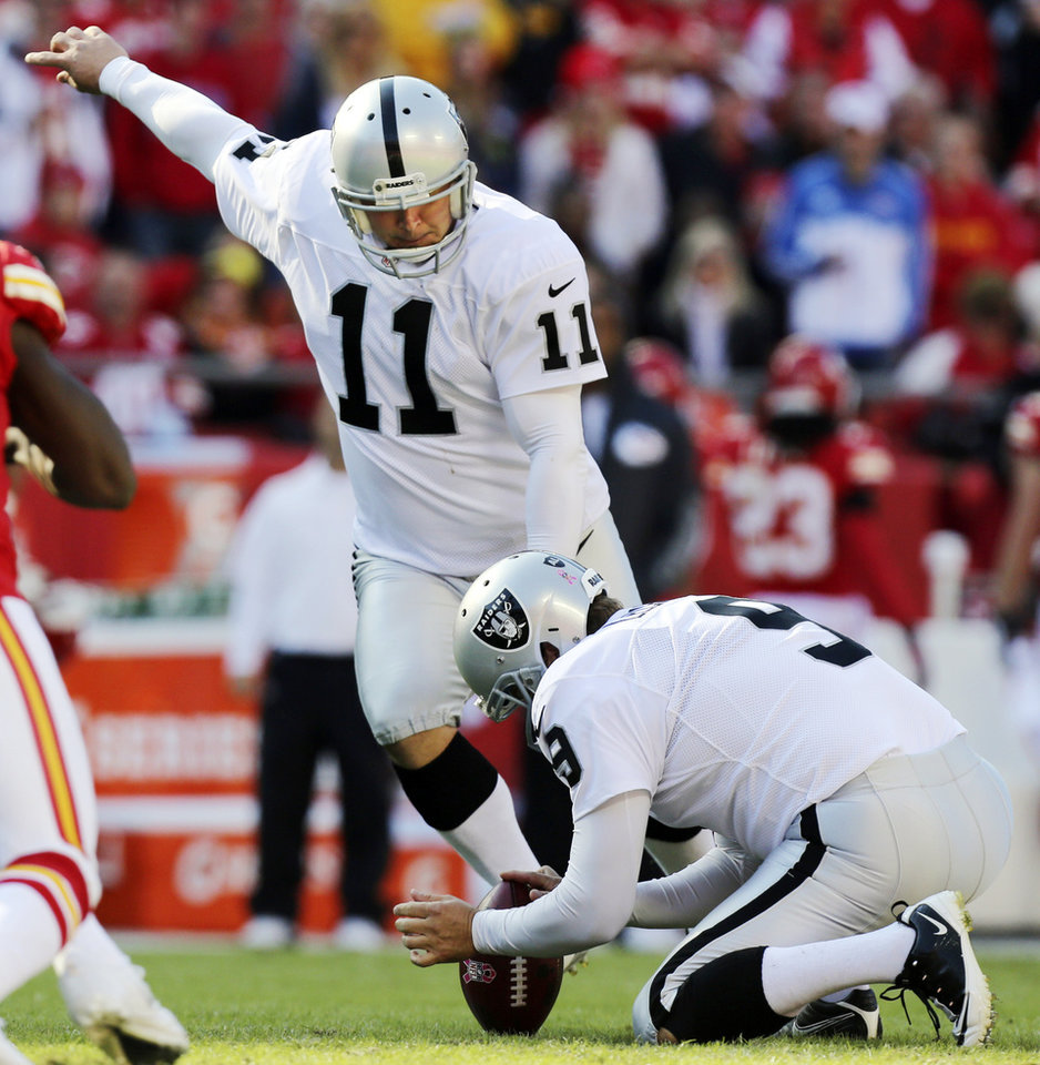 Photo -   Oakland Raiders kicker Sebastian Janikowski (11) makes a field goal as Shane Lechler (9) holds during the first half of an NFL football game against the Kansas City Chiefs at Arrowhead Stadium in Kansas City, Mo., Sunday, Oct. 28, 2012. (AP Photo/Ed Zurga)
