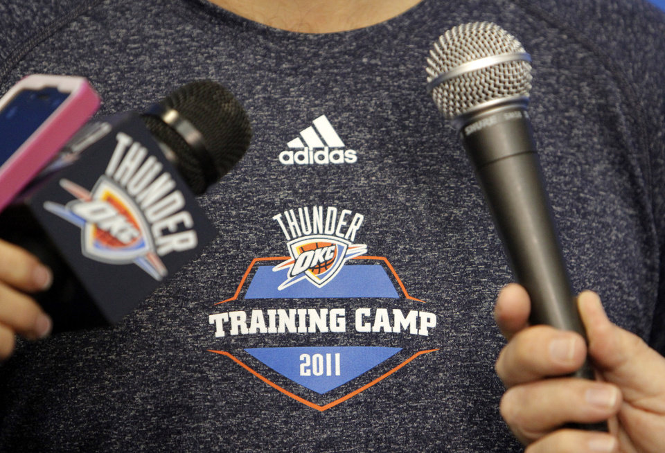 Photo - Thunder coach Scott Brooks talks with the media at the end of a practice session at the Thunder Practice Facility, Wednesday, Dec. 14, 2011. Photo by Doug Hoke, The Oklahoman