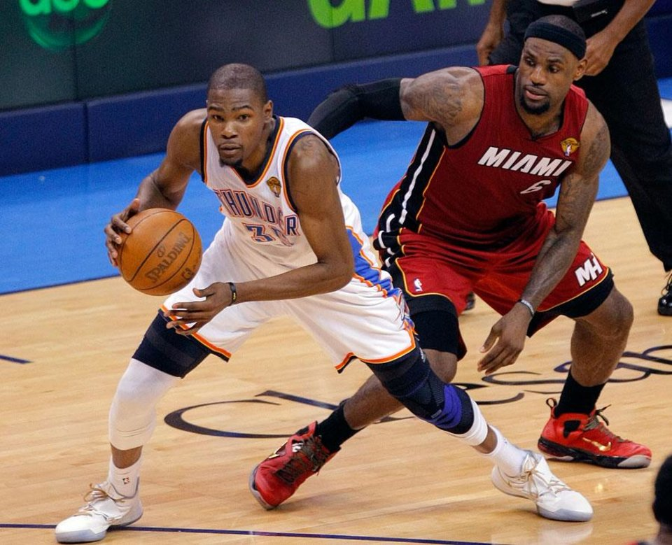 Oklahoma City's Kevin Durant (35) drives past Miami's LeBron James (6) during Game 1 of the NBA Finals between the Oklahoma City Thunder and the Miami Heat at Chesapeake Energy Arena in Oklahoma City, Tuesday, June 12, 2012. Photo by Sarah Phipps, The Oklahoman