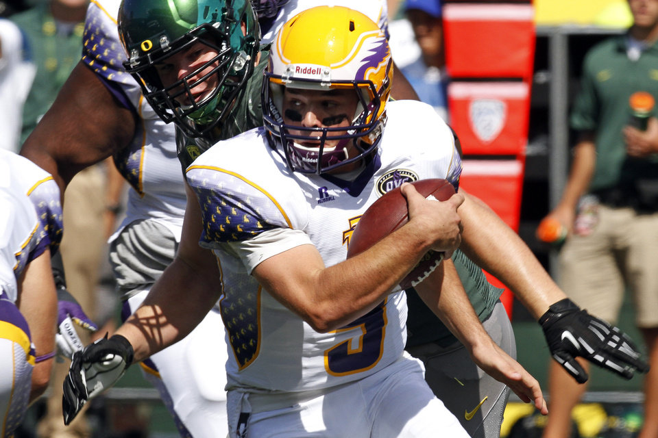 Photo -   Tennessee Tech quarterback Tre Lamb is chased out of the pocket by Oregon's Taylor Hart during the first half of their NCAA college football game in Eugene, Ore., Saturday, Sept. 15, 2012. (AP Photo/Don Ryan)