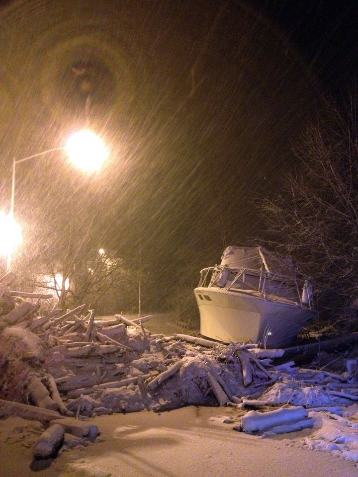 In this photo provided by Tom DeVito, a boat that washed ashore during Superstorm Sandy sits covered in snow on Hylan Blvd. in the Staten Island borough of New York as a nor'easter hits the city, Wednesday, Nov. 7, 2012. A nor'easter blustered into New York and New Jersey on Wednesday with rain and wet snow, plunging homes right back into darkness, stopping commuter trains again and inflicting another round of misery on thousands of people still reeling from Superstorm Sandy's blow more than a week ago. (AP Photo/Tom DeVito)