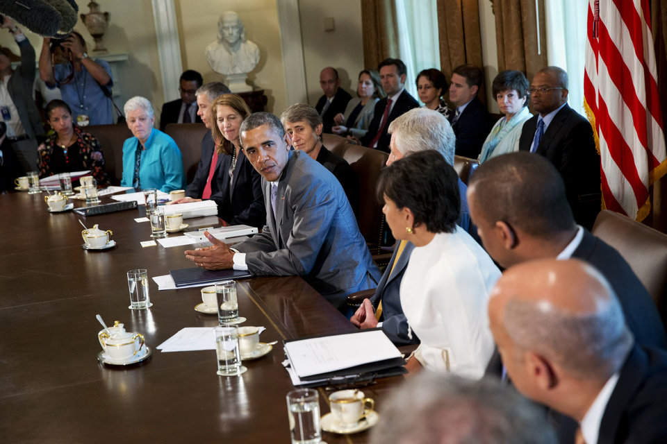 Photo - President Barack Obama meets with his cabinet members in the Cabinet Room of the White House in Washington, Tuesday, July 1, 2014. From left are, National Security Adviser Susan Rice, Environmental Protection Agency Administrator Gina McCarthy, Education Secretary Arne Duncan, Health and Human Services Secretary Sylvia Burwell, Interior Secretary Sally Jewell, and the president, Defense Secretary Chuck Hagel, Commerce Secretary Penny Pritzker, and  Transportation Secretary Anthony Foxx. (AP Photo/Jacquelyn Martin)