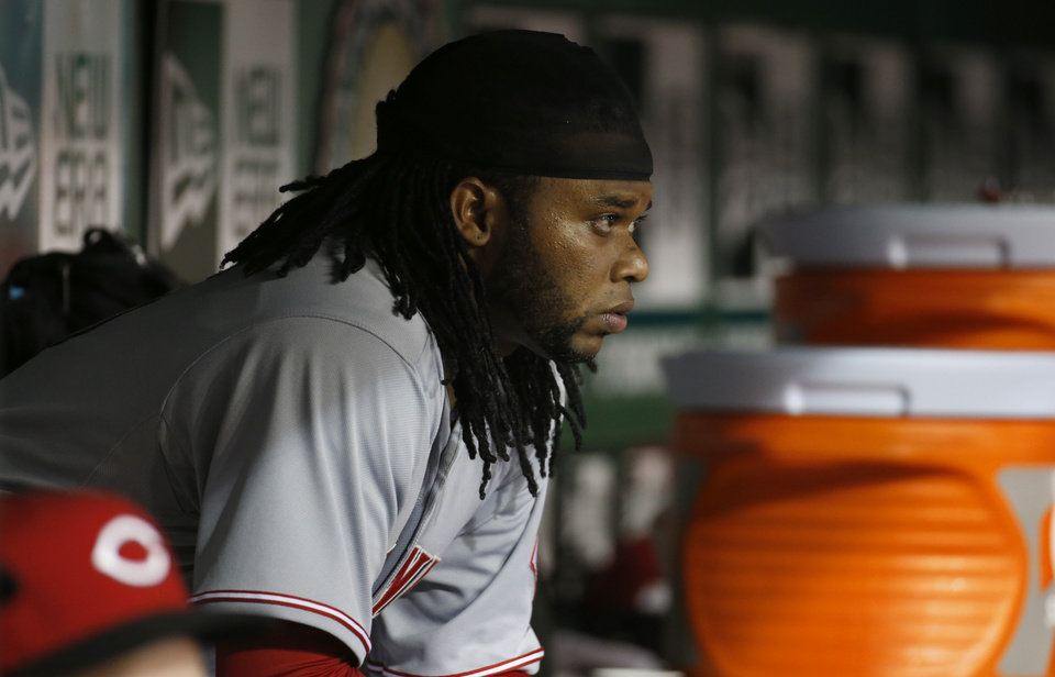 Photo - Cincinnati Reds starting pitcher Johnny Cueto sits in the dugout after being relieved during the sixth inning of a baseball game against the Washington Nationals at Nationals Park on Tuesday, May 20, 2014, in Washington. The Nationals won 9-4. (AP Photo/Alex Brandon)