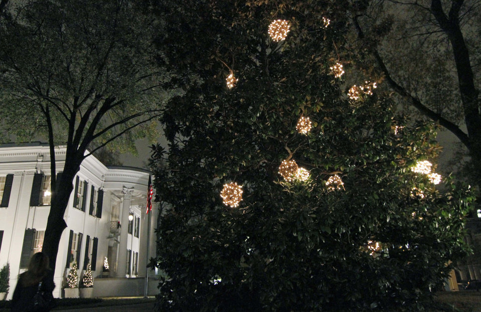 A magnolia tree outside the Governor's Mansion is decorated with holiday lighting, Wednesday, Dec. 5, 2012 in Jackson, Miss. The Capitol, the Old Capitol and the Governor's Mansion are among several historic buildings that are decked out with holiday decorations of a particular period style. The buildings are part of an Old Jackson Christmas by Candlelight Tour this Friday, Dec. 7, featuring live music and tours of each building. (AP Photo/Rogelio V. Solis)