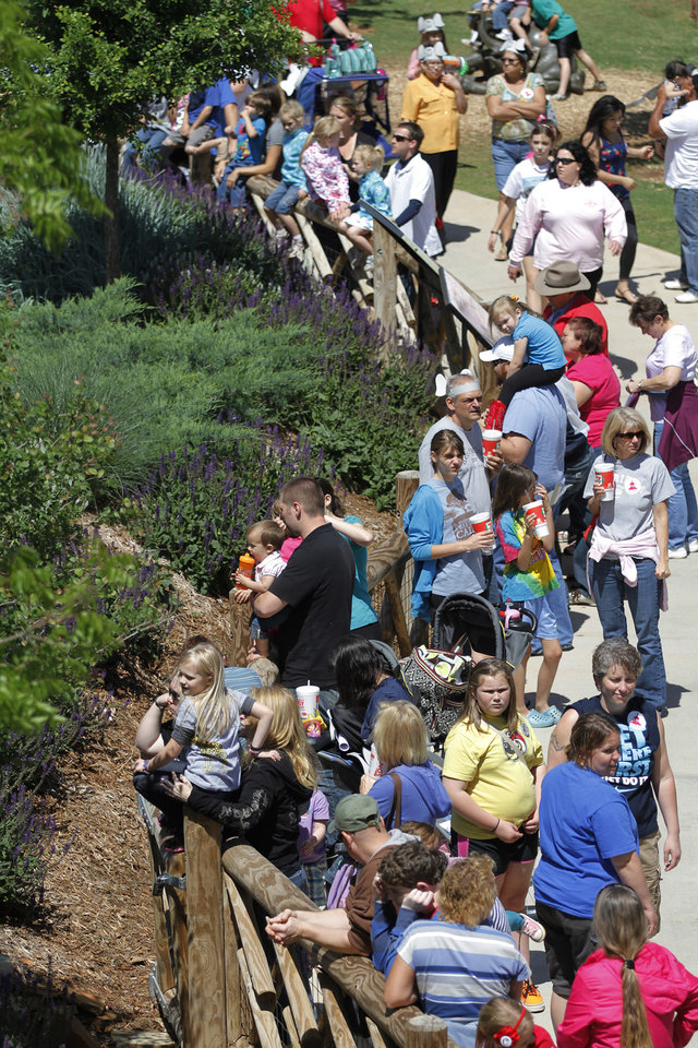 Photo - Visitors line up to see elephants during Malee's first birthday celebration at the Oklahoma City Zoo, Sunday, April 15, 2012.  Photo by Garett Fisbeck, For The Oklahoman
