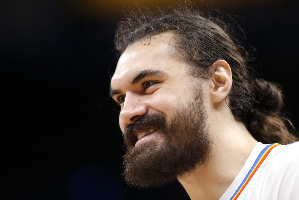 Photo - Oklahoma City's Steven Adams (12) smiles while on the bench during the NBA preseason game between the Oklahoma City Thunder and the New Zealand Breakers at the Chesapeake Energy , Thursday, Oct. 10, 2019. [Sarah Phipps/The Oklahoman]