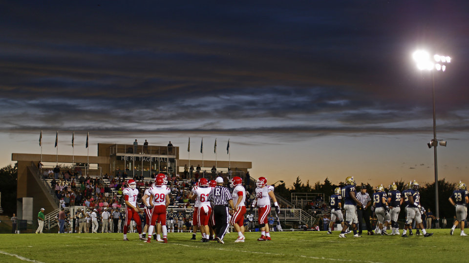 The sun sets as Davis and Heritage Hall play a high school football game in Oklahoma City, Friday, Sept. 20, 2013. Photo by Bryan Terry, The Oklahoman