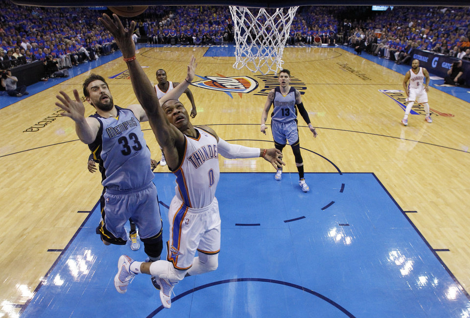 Photo -  Oklahoma City Thunder guard Russell Westbrook (0) releases a shot in front of Memphis Grizzlies center Marc Gasol (33) in the second quarter of Game 7 of an opening-round NBA basketball playoff series in Oklahoma City, Saturday, May 3, 2014. Oklahoma City won 120-109. (AP Photo/Sue Ogrocki)