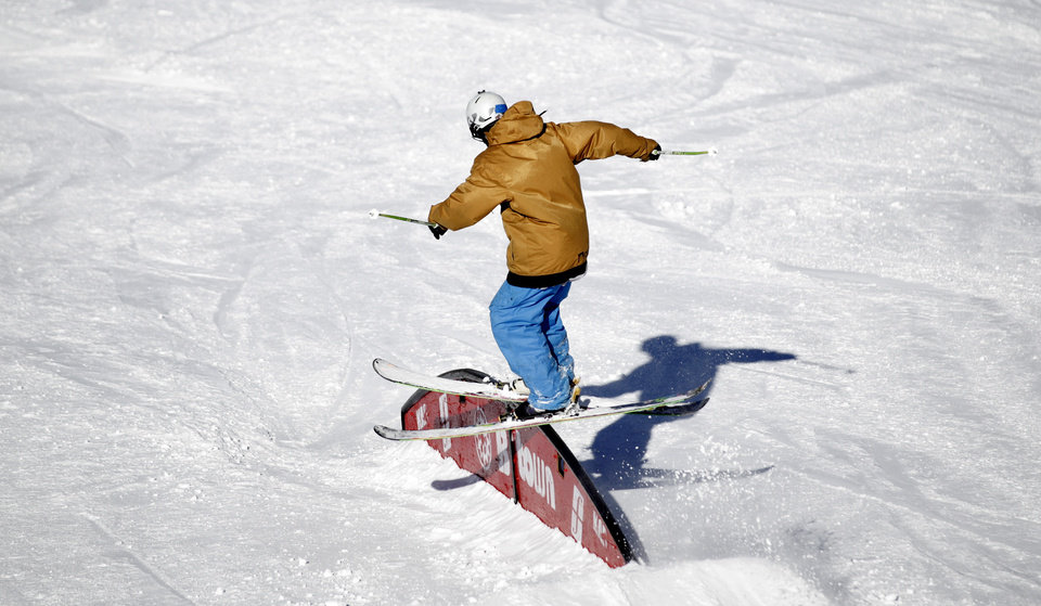 This Nov. 13, 2012 photo shows a skier making a jump in the terrain park at Brighton Ski Resort in the Wasatch Range, in Utah. The Brighton Ski Resort is in middle of the Wasatch Range's 7 resorts. If the resorts were to be combined, the Utah resorts could offer North America's largest skiing complex _ three times the size of Vail and twice as big as Whistler Blackcomb in British Columbia. (AP Photo/Rick Bowmer)