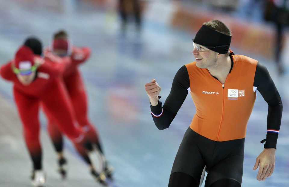 Photo - Speedskater Sven Kramer of the Netherlands gestures to a teammate as he trains at the Adler Arena Skating Center during the 2014 Winter Olympics in Sochi, Russia, Wednesday, Feb. 5, 2014. (AP Photo/Matt Dunham)