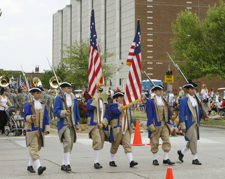 Revolutionary War reenactors begin the LibertyFest Parade in front of the University of Central Oklahoma in Edmond, OK, Saturday, July 4, 2009. By Paul Hellstern, The Oklahoman