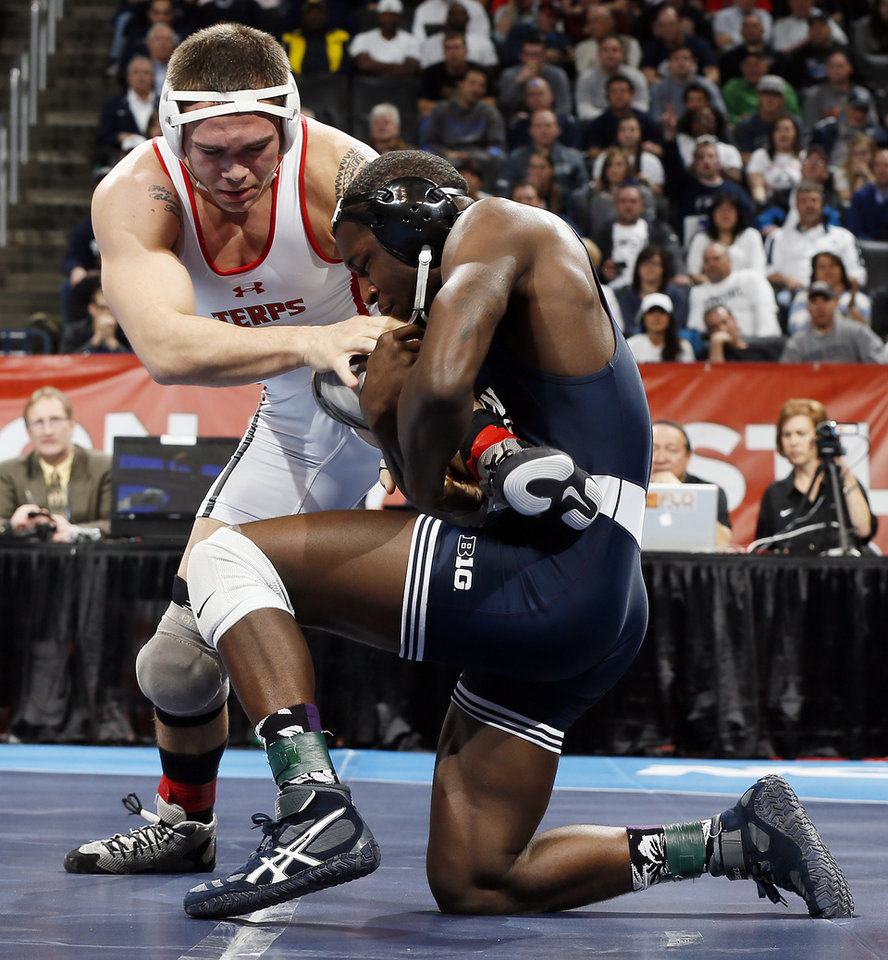 Photo - Penn State's Edward Ruth, right, wrestles Maryland's Jimmy Sheptock for the 184-pound national championship in the 2014 NCAA Div. I Wrestling Championships at Chesapeake Energy Arena in Oklahoma City, Saturday, March 22, 2014. Photo by Nate Billings, The Oklahoman