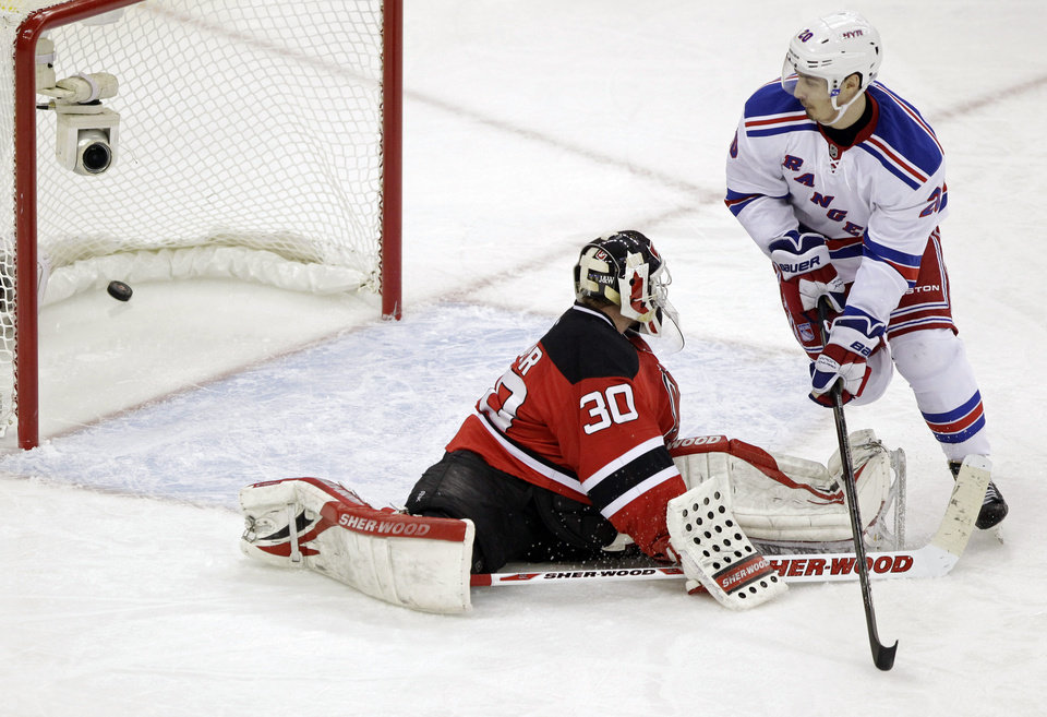 Photo -   New York Rangers left wing Chris Kreider, right, scores past New Jersey Devils goalie Martin Brodeur during the third period of Game 3 of an NHL hockey Stanley Cup Eastern Conference final playoff series, Saturday, May 19, 2012, in Newark, N.J. (AP Photo/Julio Cortez)