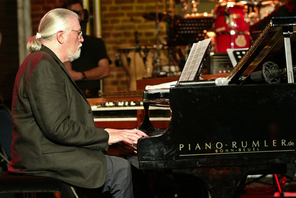 Photo -   FILE - In this file picture dated Tuesday, Oct. 5, 2004 British musician Jon Lord, plays piano during a test run for his concert in Cologne, western Germany. Deep Purple's Jon Lord, who has died aged 71, Monday, July 16, 2012. The Leicester-born keyboard player, who had pancreatic cancer, died in London today. (AP Poto/Hermann J. Knippertz,File)