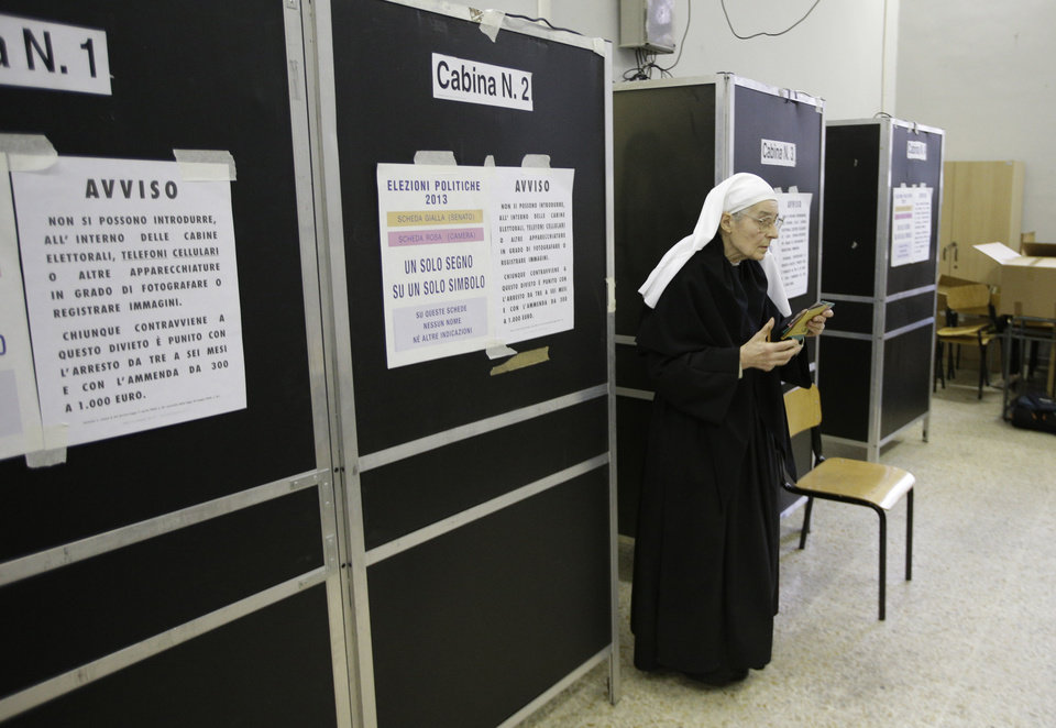 A nun exits a booth as she votes in a polling station in downtown Rome, Sunday, Feb. 24, 2013. Italy votes in a watershed parliamentary election Sunday and Monday that could shape the future of one of Europe's biggest economies. (AP Photo/Andrew Medichini)