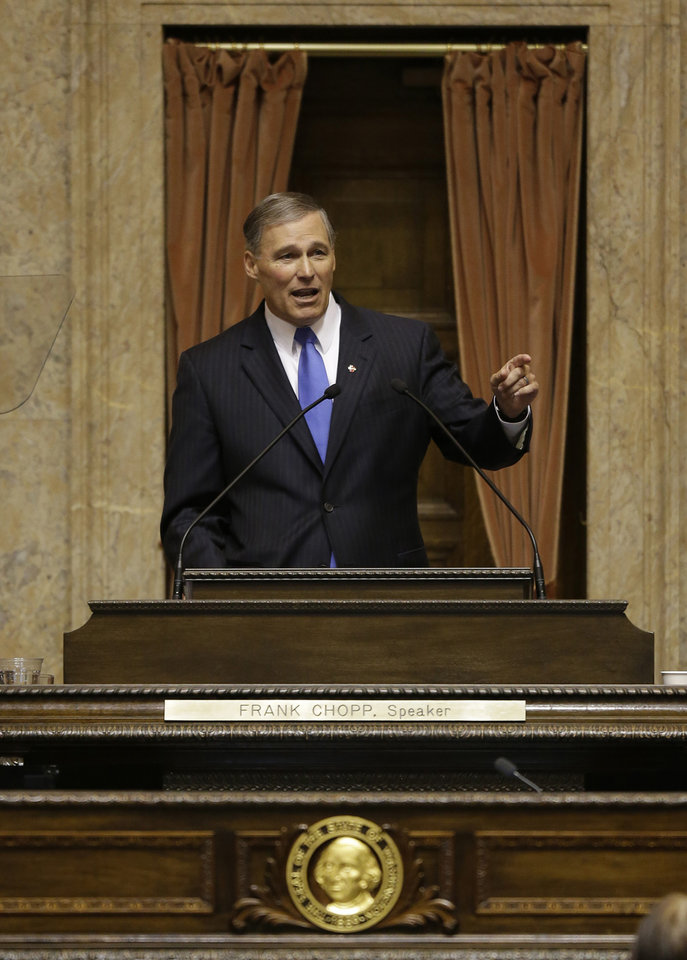 Washington Gov. Jay Inslee speaks to a joint session of the Washington Legislature, Wednesday, Jan. 16, 2013, shortly after being sworn in as Governor, at the Capitol in Olympia, Wash. (AP Photo/Ted S. Warren)