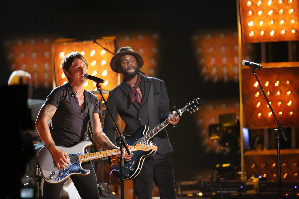 """Photo - Keith Urban, left, and Gary Clark, Jr. perform """"Cop Car"""" on stage at the 56th annual Grammy Awards at Staples Center on Sunday, Jan. 26, 2014, in Los Angeles. (Photo by Matt Sayles/Invision/AP)"""