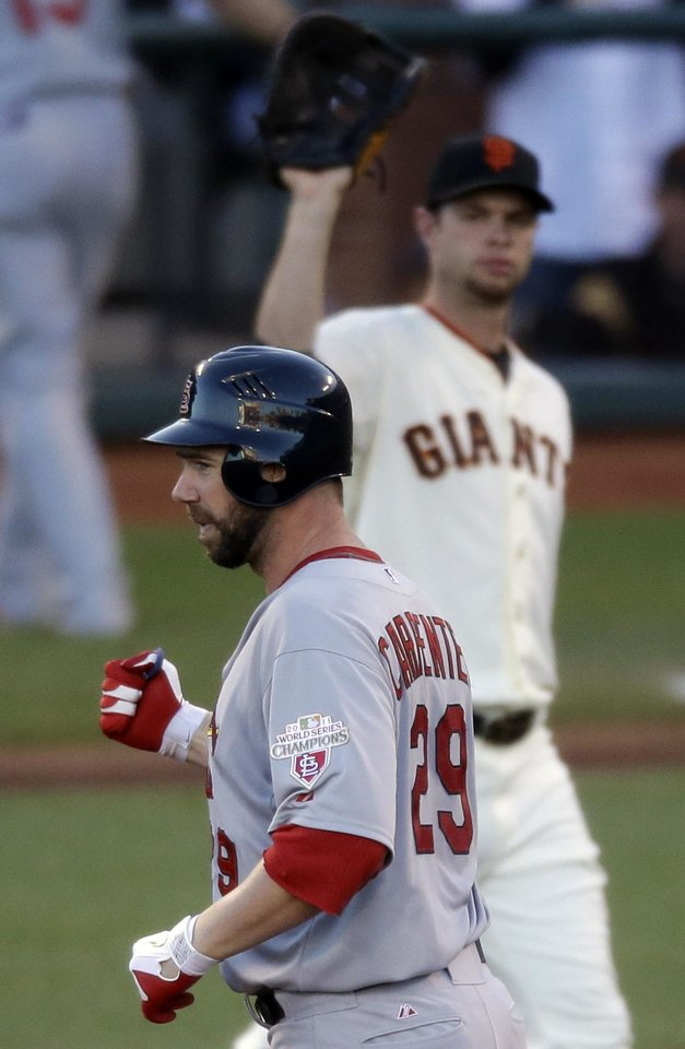 Photo -   St. Louis Cardinals' Chris Carpenter reacts after hitting an RBI double during the second inning of Game 2 of baseball's National League championship series against the San Francisco Giants Monday, Oct. 15, 2012, in San Francisco. (AP Photo/Mark Humphrey)
