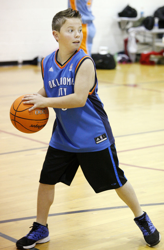 Dillon Smith, 11, looks to pass the ball during March Madness basketball camp at the YMCA in Bethany. Photo by Paul B. Southerland, The Oklahoman <strong>PAUL B. SOUTHERLAND - PAUL B. SOUTHERLAND</strong>