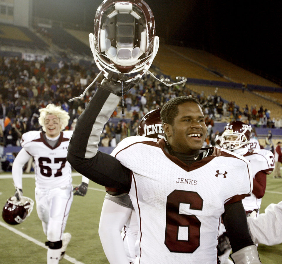 Photo - Jenks' Chris Adkins (6) celebrates on the field following his team's 28-7 win of the Class 6A high school football state championship game between Jenks and Enid at Skelly Stadium in Tulsa, Okla., Friday, Dec. 8, 2006. By Matt Strasen, The Oklahoman  ORG XMIT: KOD