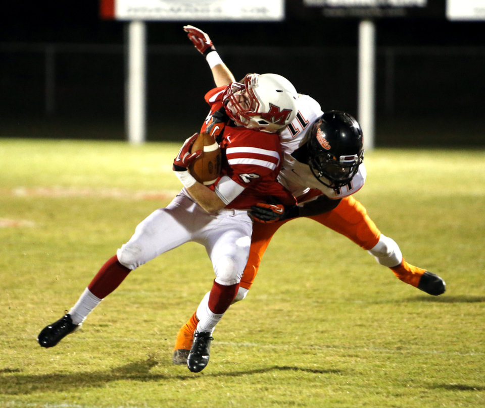 Douglass' Anthony Williams tackles McLoud's Will Olds in high school football on Thursday, Oct. 18, 2012 in McLoud , Okla.  Photo by Steve Sisney, The Oklahoman