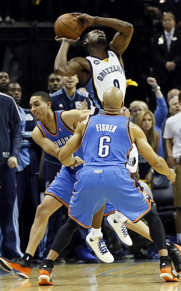 Memphis' Tony Allen (9) is fouled by Oklahoma City's Kevin Martin (23) near Derek Fisher (6) after Allen stole an inbounds pass from the Thunder late in overtime during Game 4 of the second-round NBA basketball playoff series between the Oklahoma City Thunder and the Memphis Grizzlies at FedExForum in Memphis, Tenn., Monday, May 13, 2013. Memphis won 103-97 in overtime. Photo by Nate Billings, The Oklahoman