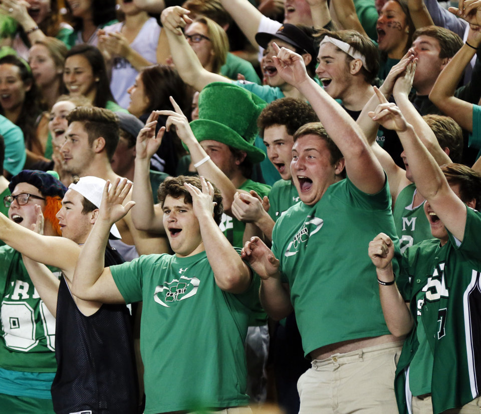Photo - Bishop McGuinness fans cheer during a Class 5A boys semifinal game in the state basketball championship tournament between Bishop McGuinness and Bishop Kelley at the Mabee Center in Tulsa, Okla., Friday, March 14, 2014. Photo by Nate Billings, The Oklahoman