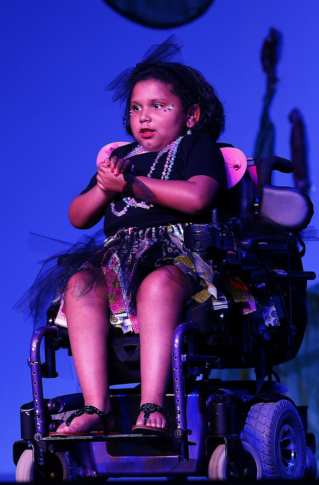 Photo - Bri Johnson performs during a musical show at Special Care in Oklahoma City, Thursday, July 24, 2014. Photo by Sarah Phipps, The Oklahoman