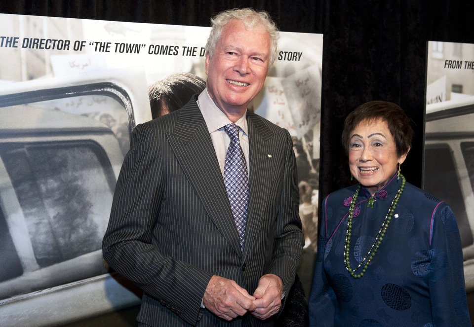 Photo - FILE - In this Wednesday, Oct. 10, 2012 file photo, former Canadian Ambassador Ken Taylor and his wife Pat, pose for photographers at the premiere of the film Argo in Washington. Taylor, Canada's former ambassador in Iran, who protected Americans at great personal risk during the Iran hostage crisis of 1979, says if