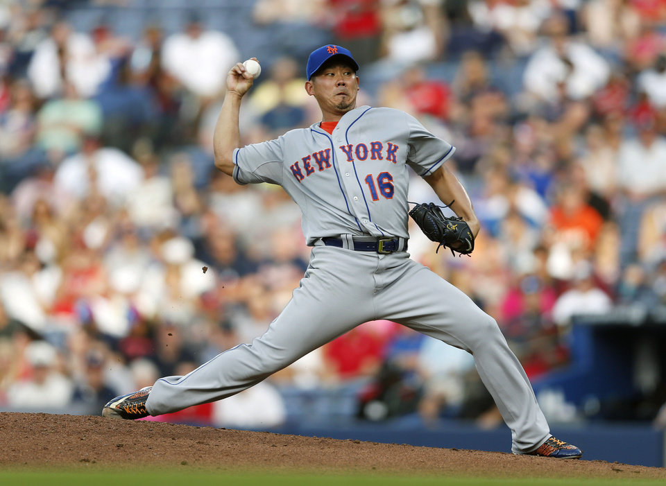 Photo - New York Mets pitcher Daisuke Matsuzaka (16) works in the first inning of a baseball game against the Atlanta Braves in Atlanta, Tuesday, July 1, 2014.  (AP Photo/John Bazemore)