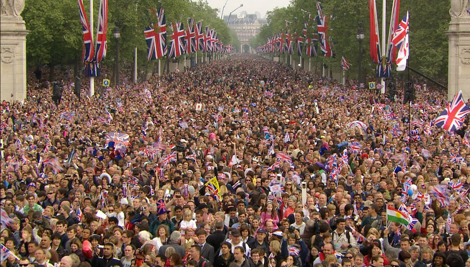 Photo - The crowd moves down the Mall, toward Buckingham Palace, druring the Royal Wedding in London on Friday, April, 29, 2011. (AP Photo/APTN) EDITORIAL USE ONLY NO ARCHIVE PHOTO TO BE USED SOLELY TO ILLUSTRATE NEWS REPORTING OR COMMENTARY ON THE FACTS OR EVENTS DEPICTED IN THIS IMAGE ORG XMIT: RWVM314