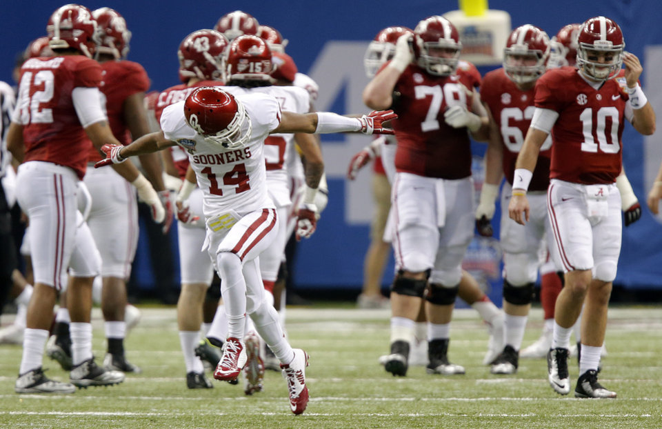 Photo - Oklahoma's Aaron Colvin (14) reacts after Alabama misses a field goal at the end of the first half during the NCAA football BCS Sugar Bowl game between the University of Oklahoma Sooners (OU) and the University of Alabama Crimson Tide (UA) at the Superdome in New Orleans, La., Thursday, Jan. 2, 2014.  .Photo by Chris Landsberger, The Oklahoman