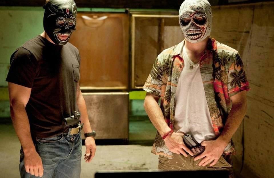 "Taylor Kitsch and Aaron Johnson mask up in ""Savages."" <strong></strong>"