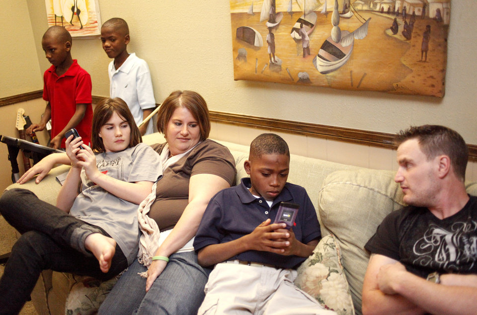 The Lenharts gather in their family room, Wednesday, Feb. 3, 2010, in Oklahoma City. Pictured from left are Jimso, 8, Jackson,11, Ashlyn, 12, Tiffanie, Jedone, 12,  and Jacob. Photo by Sarah Phipps, The Oklahoman.