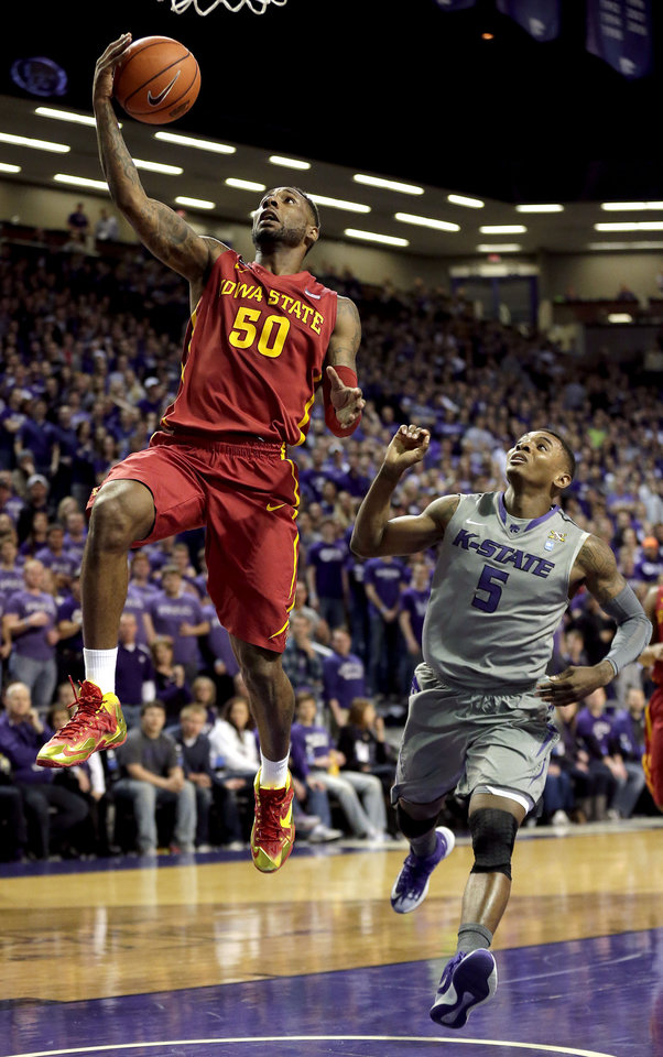 Photo - Iowa State's DeAndre Kane (50) gets past Kansas State's Jevon Thomas (5) to put up a shot during the first half of an NCAA college basketball game Saturday, March 1, 2014, in Manhattan, Kan. (AP Photo/Charlie Riedel)
