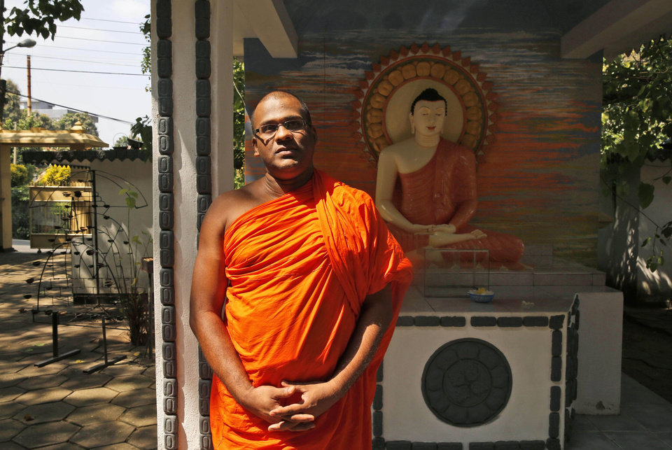 Photo - In this Sunday, Nov. 17, 2013 photo, Galagoda Atte Gnanasara, a 37-year-old Buddhist monk who founded the Bodu Bala Sena (BBS) group, or Buddhist Power Force in 2012, poses for a photo at the BBS office in Colombo, Sri Lanka. With a bloody civil war over and a cautious peace at hand, the group of hardline Buddhist monks is rallying Sri Lankans against what they say is a pernicious threat: Muslims. In just over a year, the saffron-swathed monks of BBS have amassed a huge following, drawing thousands of fist-pumping followers who rail against the country's Muslim minority. (AP Photo/Manish Swarup)